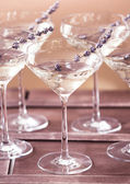 Glasses of with white champagne decorated with lavender — Stock Photo
