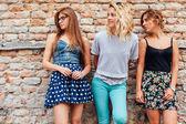 Three teenage girls looking at something interesting — Stock Photo