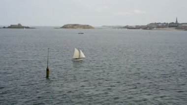 Sailboat at sea, view from the fortress of St Malo, France — Stock Video