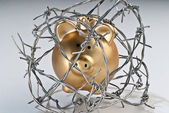 Golden piggy bank behind barbed wire — Stock Photo
