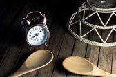Old Alarm Clock and spoon and basket — Stock Photo