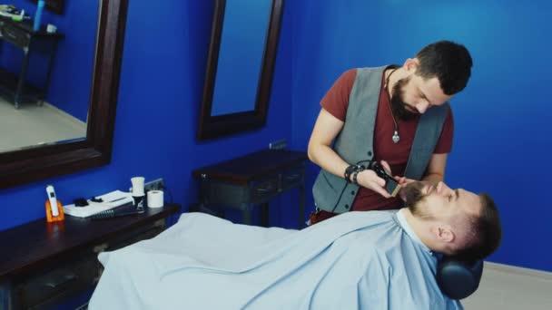 Haircutting stock videos royalty free haircutting - Barber vs hair salon ...