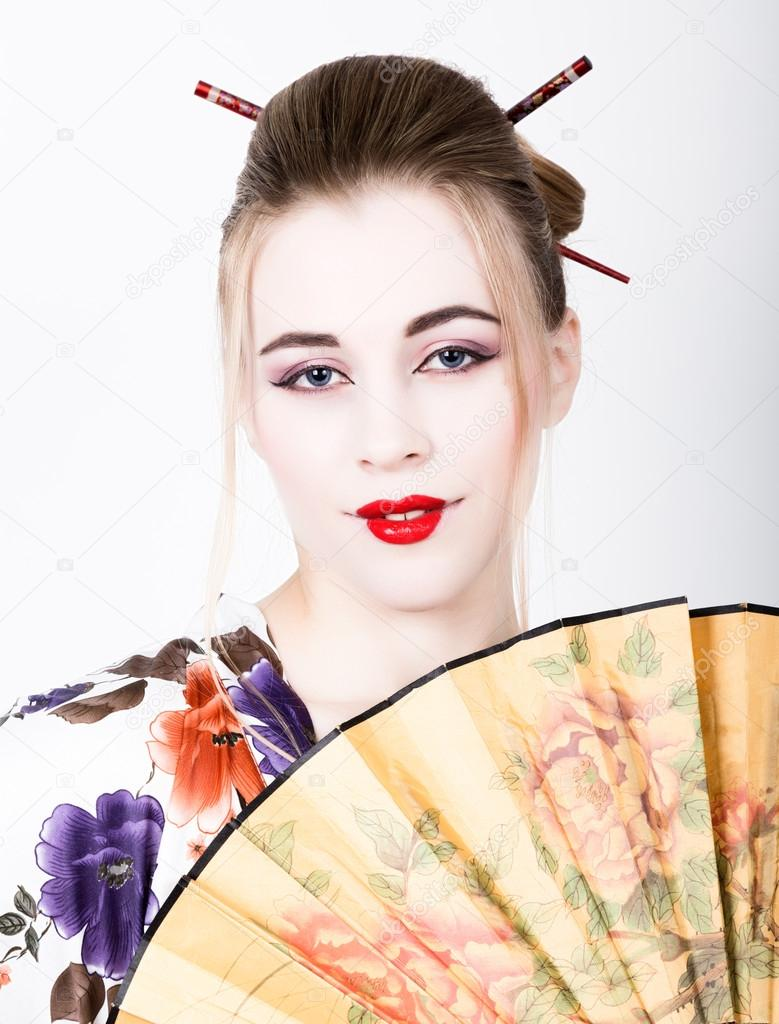 Beautiful Girl Dressed As A Geisha She Holds A Chinese