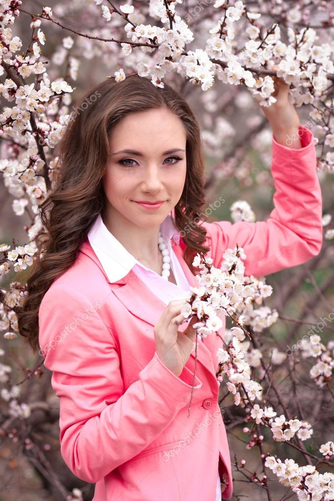 Very Beautiful Blond Teen Girl With: Very Beautiful Girl In Blossoming Trees In Spring Garden