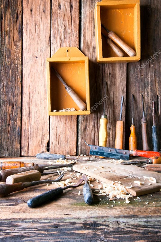 Chisels and carved piece of wood in traditional carpenter worksh – Stock Image