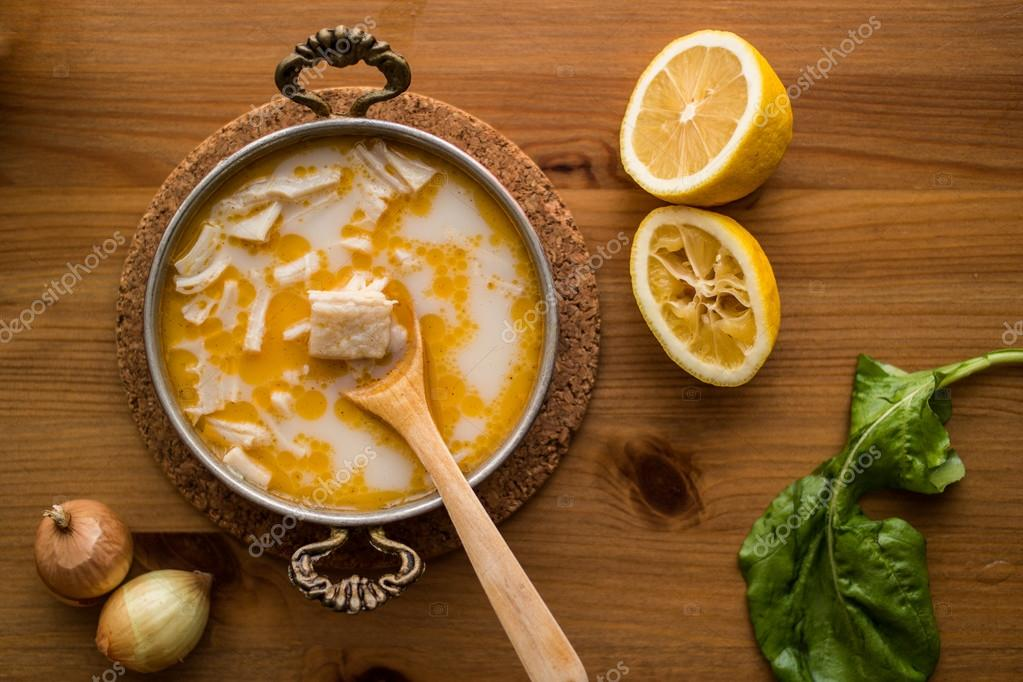 traditional tripe soup on rustic background with wooden table ...