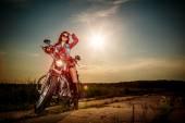Biker girl sitting on motorcycle