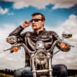 Постер, плакат: Biker man on his motorcycle