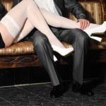 Постер, плакат: Girl in white stockings seduces man indoors