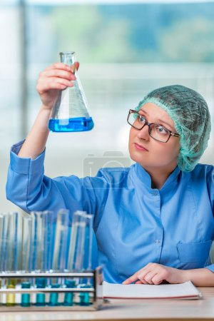Experienced lab assistant working on chemical solutions