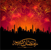Arabic Islamic calligraphy of golden text Ramadan Mubarak in mosque silhouetted night background with fireworks
