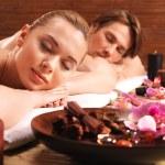 Couple lying on massage desks