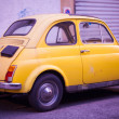 Постер, плакат: View of yellow Fiat Cinquecento