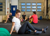 Woman Doing Relaxation Exercise In Crossfit Gym