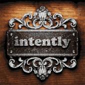 Intently vector metal word on wood