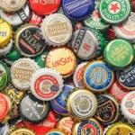Постер, плакат: Beer bottle caps background