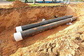 Pipes for water in a trench