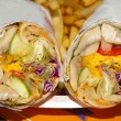 Постер, плакат: Vegetables with mushrooms wrapped in pita