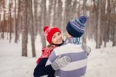 Outdoor happy couple in love posing in cold winter weather. Youn