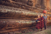 Buddhist novice monks walking alms
