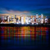 Abstract panoramic evening background with night illumination of city