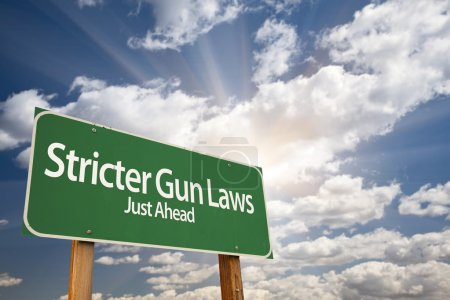 Постер, плакат: Stricter Gun Laws Green Road Sign Over Clouds, холст на подрамнике