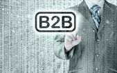 Podnikatel ukazující na slovo b2b
