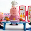Постер, плакат: Peppa Pig and George Pig eating cupcakes