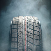 Zimní pneumatiky v kouři