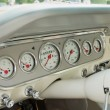 Постер, плакат: Silver and white dashboard of a classic car