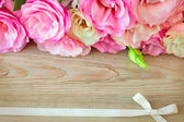 Flowers border and  retro ribbon  on the wooden surface, vintage