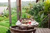 Perfrect healthy breakfast on patio in summer day