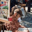 Постер, плакат: Local Artist at Work in Place du Tertre of Paris Montmartre