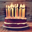 Постер, плакат: Birthday cake with some lit candles filtered