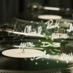 Постер, плакат: Turntable with vinyl and music genres writen