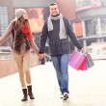 Постер, плакат: Cheerful couple shopping in the city