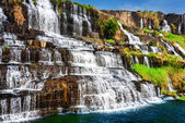 Beautiful natural cascades of waterfall with crystal clear water