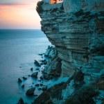 Постер, плакат: Sunset over the Old Town of Bonifacio the limestone cliff
