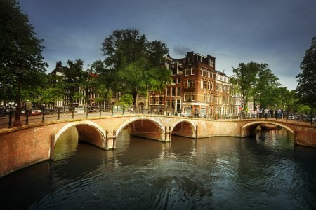 Amsterdam canals with bridge and typical houses, Holland