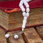 Постер, плакат: Holy Quran with beads