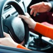 Постер, плакат: Young woman at driving lesson