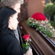 Постер, плакат: People at Funeral with coffin