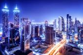 Dubai downtown night scene, UAE, beautiful modern buildings, bright glowing lights, luxurious travel and touris