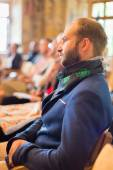 Podnikatel v publiku na obchodní konferenci