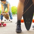 Постер, плакат: Teenage girl urban long board riding