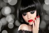 Makeup. Manicured nails. Beauty girl portrait. Back short bob ha