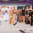 Постер, плакат: BUCHAREST ROMANIA DECEMBER 4: Fashion models wears clothes ma