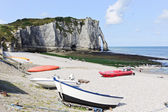 Boats on resort beach and view of cliff in Etretat