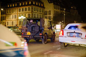 Police officers in military vehicle patrol French street
