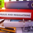 Постер, плакат: Rules And Regulations on Red Ring Binder Blurred Toned Image